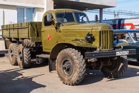 Truck-all-terrain vehicle ZIL-157. Orenburg, Russia - May, 8, 2019: Retro car in a parking lot near the building of the railway station