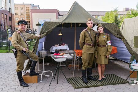 People in the uniform of military medics, against the background of the layout of the military field hospital. Orenburg, Russia - May 9, 2019: Celebration of Victory Day Éditoriale