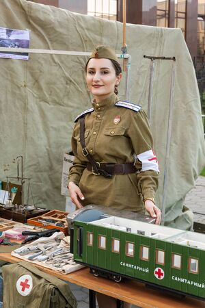 The girl in the uniformed medic, the Great Patriotic War. Orenburg, Russia - May 9, 2019: Celebration of Victory Day