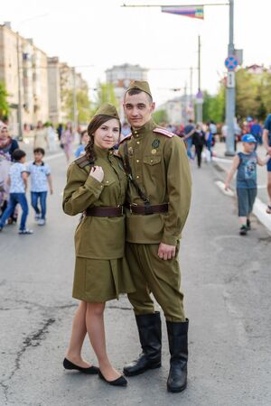 A girl and a guy in uniform of military physicians, the Great Patriotic War. Orenburg, Russia - May 9, 2019: Celebration of Victory Day