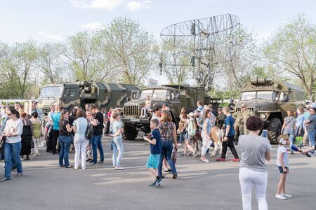 Visitors to the exhibition of military equipment. Orenburg, Russia - May 9, 2019: Celebration of Victory Day