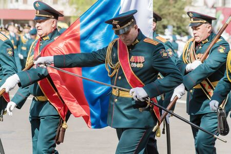 Officer of the banner group, sheathes his saber. Orenburg, Russia - May 9, 2019: Victory Parade on Lenin Square