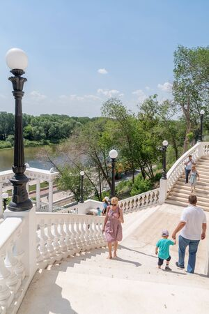 Orenburg, Russia - June, 1, 2019: Descent to the Urals. Steps of stairs leading down to the embankment. Architectural landmark