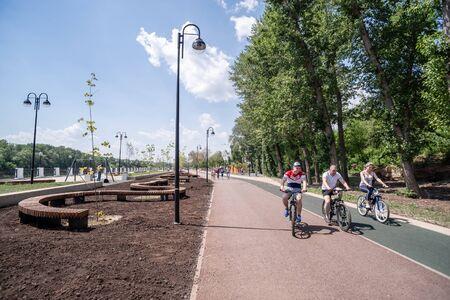 Orenburg, Russia - June, 1, 2019: Embankment of the Urals. Summer. Cyclists riding the bike path Sajtókép