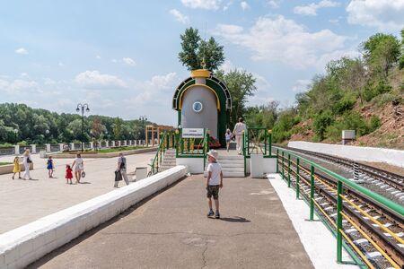 Orenburg, Russia - June, 1, 2019: Embankment of the Urals. Summer. Station of the Orenburg Childrens Railway Sajtókép