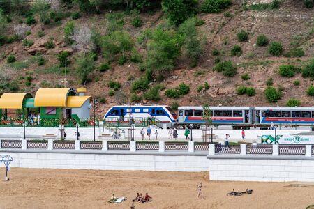 Orenburg, Russia - June, 1, 2019: Orenburg Childrens Railway. A locomotive with passenger cars arrives at Komsomolskaya station