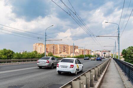Orenburg, Russia - June, 1, 2019: Traffic on the bridge over the Ural River. Street Donguzskaya Sajtókép
