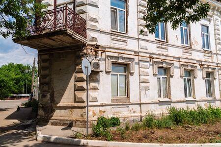 Orenburg, Russia - June, 1, 2019: Old dilapidated house on Naberezhnaya street