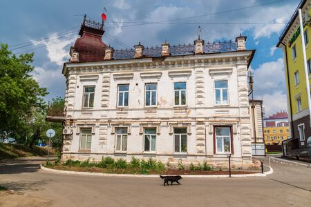 Orenburg, Russia - June, 1, 2019: Facade of an old dilapidated house on Naberezhnaya street Sajtókép