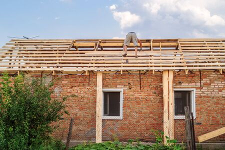 Construction of the roof of a rural house. Photo taken in Russia, in the countryside