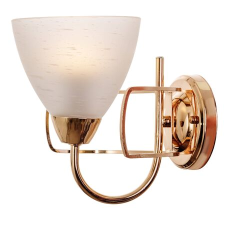 Sconce with a white frosted glass shade, made of golden metal. Modern wall lamp isolated on white background