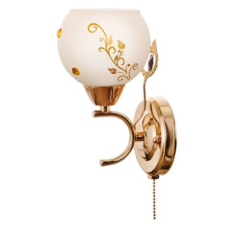 Sconce with a white glass shade with floral ornaments, made of golden metal. Stylish wall lamp isolated on white background