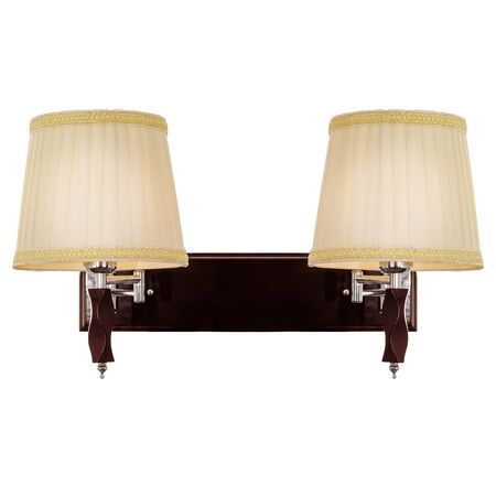 Two-lamp sconce with two fabric lampshades, made of shiny metal and wood. Classic wall lamp isolated on white background