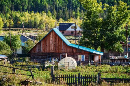 Mountain village in the rural wilderness. Russia, mountain Altai, Ongudaysky district, picture taken in the village of Tuecta