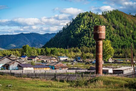Water tower in a mountain village. Russia, mountain Altai, Ongudaysky district, picture taken in the village of Tuecta