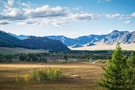 Rural mountain landscape in the fall. Russia, mountain Altai, Ongudaysky district, Karakol river valley, near the village of Bichiktu-Boom