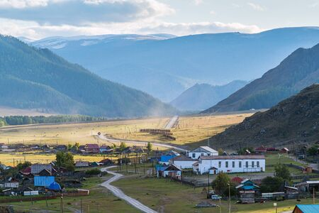 Rural autumn mountain landscape with a village. Russia, mountain Altai, Ongudaysky district, the village of Bichiktu-Boom Reklamní fotografie