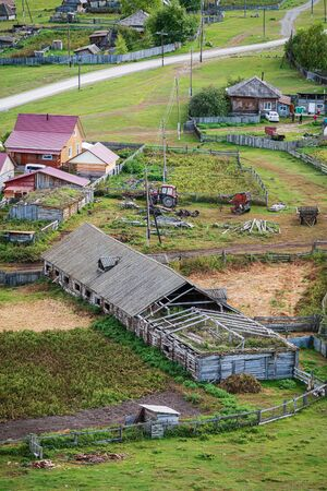 Livestock farm in the village, top view. Russia, mountain Altai, Ongudaysky district, the village of Bichiktu-Boom