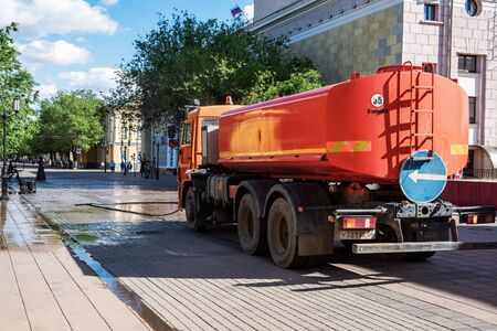 Orenburg, Russia - June, 14, 2019: Watering machine on a city street. Tank truck on the chassis of a KamAZ car Sajtókép
