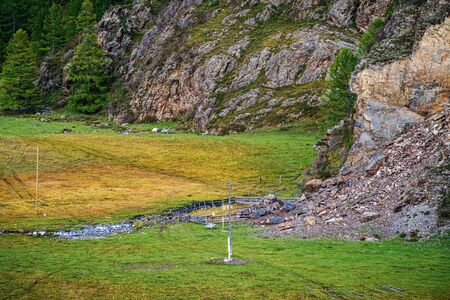 Pagan ritual place on the side of the mountains. Russia, mountain Altai, Ongudaysky district, Karakol valley
