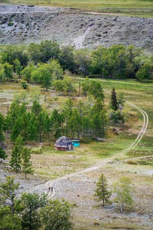 Traditional Altai housing ail. Autumn landscape in the Altai mountains, aerial view