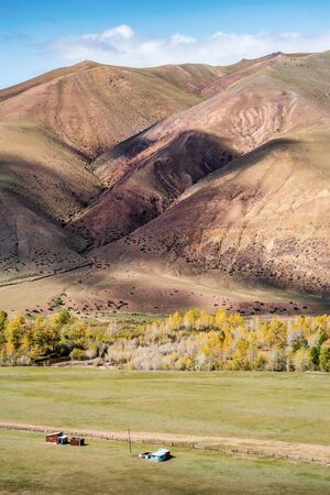 Shadows of clouds on the slopes of the hills in the tract Kyzylshin. Kosh-Agachsky District, Altai Republic, Russia