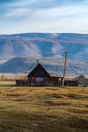 Wooden house with satellite TV antenna. Kyzyl-Tash village, Kosh-Agach district, Altai Republic, Russia