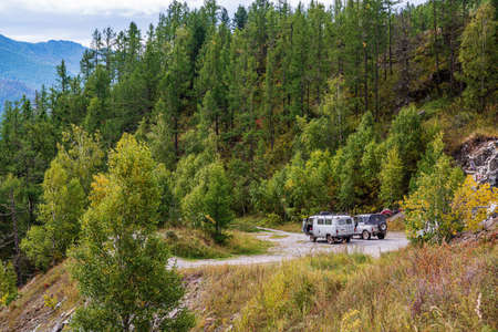 Chike-Taman Pass, Altai Mountains, Russia - September, 13, 2019: UAZ off-road vehicles at the observation deck