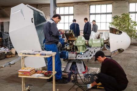 Orenburg, Russia - May, 26, 2020: Workers are engaged in the manufacture of a wind turbine in the factory floor 에디토리얼