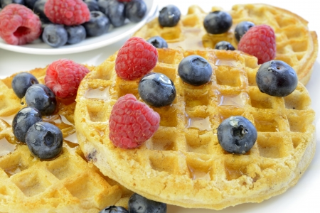 Waffles with blueberries and raspberries closeup
