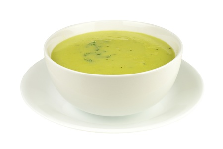 Asparagus soup in a bowl isolated on a white background