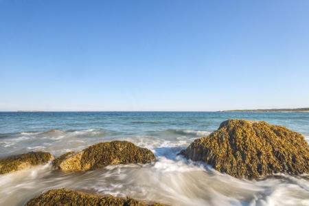 Ocean waves lash line impact rock on the beach  Crystal Crescent Beach, Nova Scotia, Canada  photo