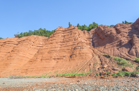The red rocks of the Blomidon cliffs at low tide  Blomidon Provincial Park, Nova Scotia, Canada  photo