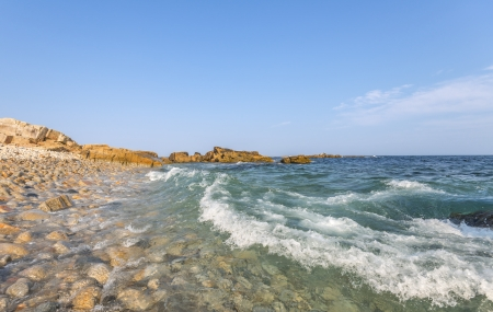 Ocean waves crashing against a pebble shore  Duncan photo