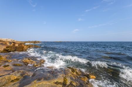Ocean waves crashing against a rocky shore  Duncan photo