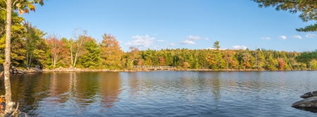 Idyllic fall foliage scene with reflections on lake  Dollar Lake, Nova Scotia, Canada  photo
