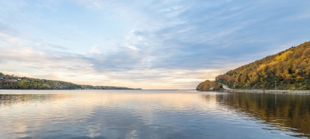 Panorama of harbour in the autumn with reflections of clouds photo