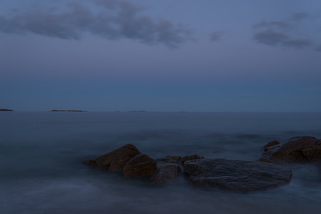 crescent: Twilight view of rocky coast  Crystal Crescent Beach, Nova Scotia, Canada