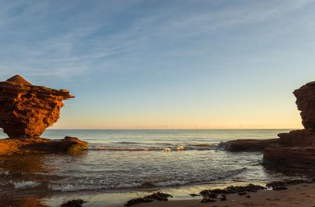 gables: Red sandstone rocks at high tide  Green Gables Shore, Prince Edward Island , Canada