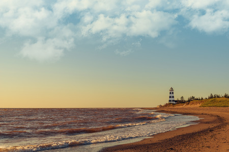 navigation aid: West Point Lighthouse at Sunset (Prince Edward Island, Canada)