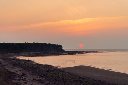 the mainland: Sunset at Northumberland Strait near the Confederation Bridge mainland New Brunswick Stock Photo