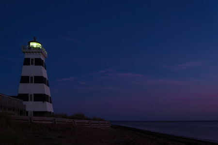 navigational light: West Point Lighthouse at dusk Prince Edward Island, Canada Stock Photo