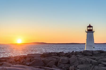 nova scotia: Peggys Cove Lighthouse at Sunset (Nova Scotia, Canada) Stock Photo