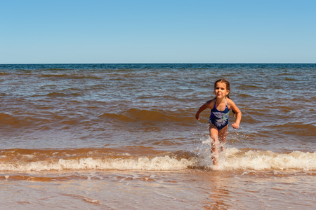 Little girl playing on the Cavendish beach (Prince Edward Island, Canada) Stock Photo
