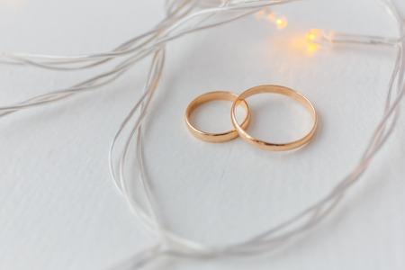 Wedding rings on white wooden floor Stock Photo