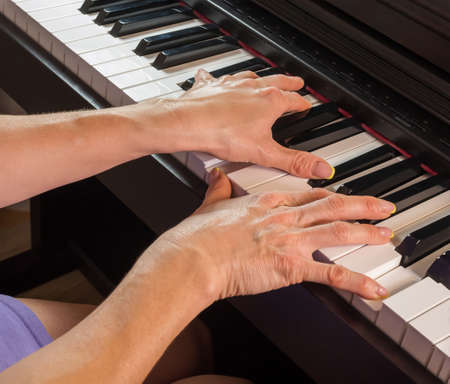 Unrecognizable young caucasian female plays the piano Zdjęcie Seryjne