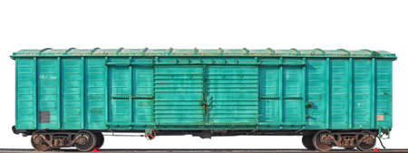 A green boxcar of standard design on the rails isolated on the white background. Front view.