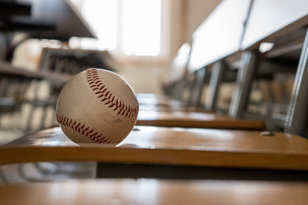 Baseball on a classroom bench