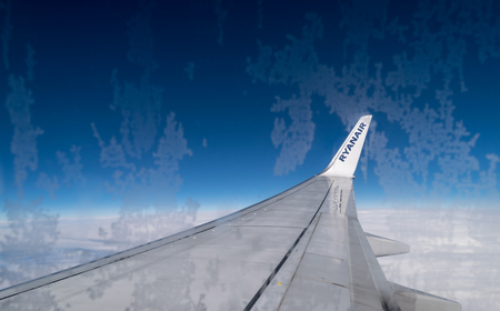 ITALY – FEB 18: View from RYANAIR AILINES Boeing 737 on February, 2016 in Italy. Ryanair Ltd. is an Irish low-cost airline headquartered in Swords, Dublin, Ireland.