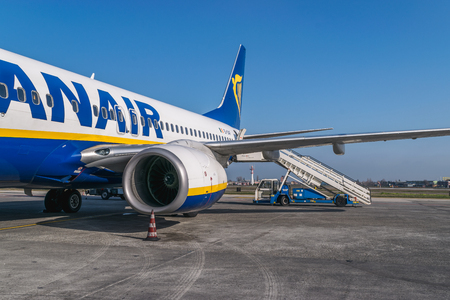 BOLOGNA, ITALY – FEBRUARY 2016: Ryanair jetliner waiting for the passengers at the Bologna airport, Italy. Ryanair Ltd. is an Irish low-cost airline headquartered in Swords, Dublin, Ireland.
